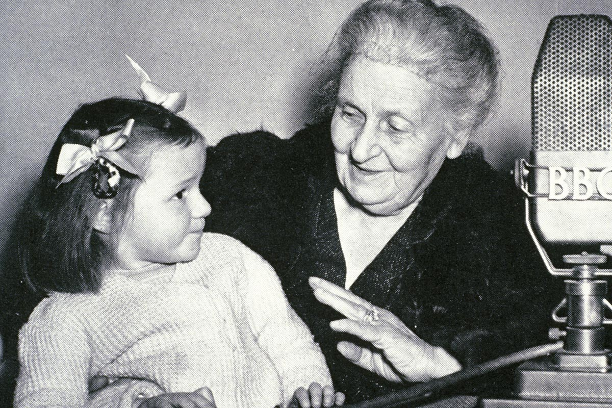 Maria Montessori and young girl
