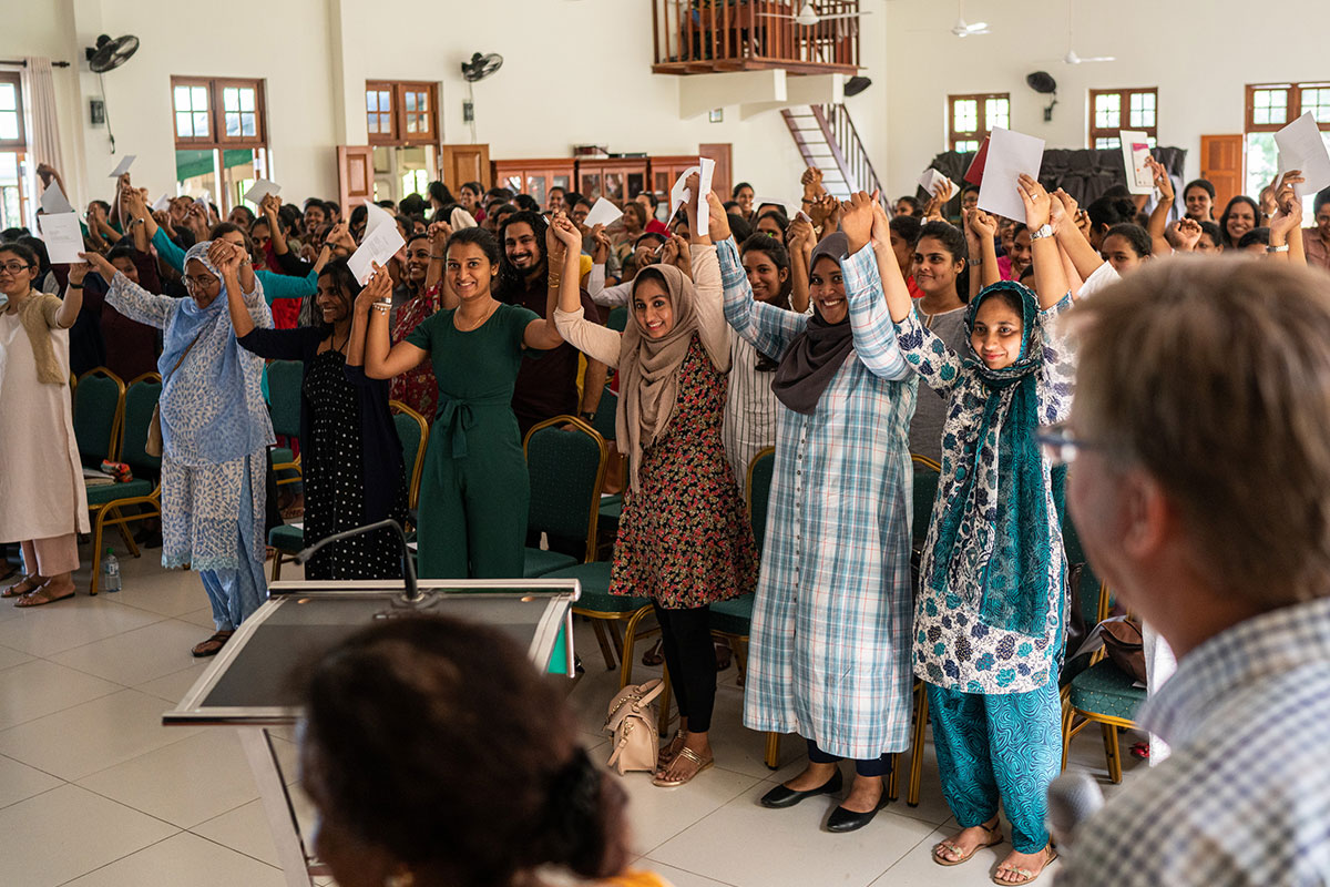 St. Bridget's AMI Training Center students raising hands and singing