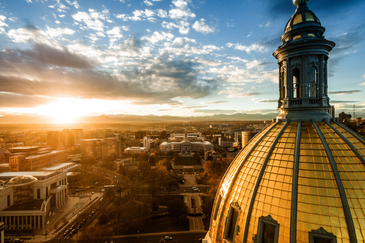 Aerial photograph of a sunset over the Colorado state capital building in Denver