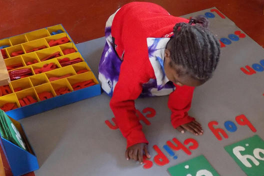 Child using moveable alphabet